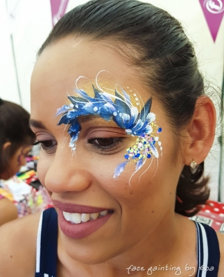 adults face paint blue flowers eye design Stafford