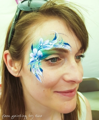 adults face paint blue flowers eye design Telford
