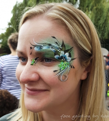 adults face paint green flowers glitter eye design Shropshire