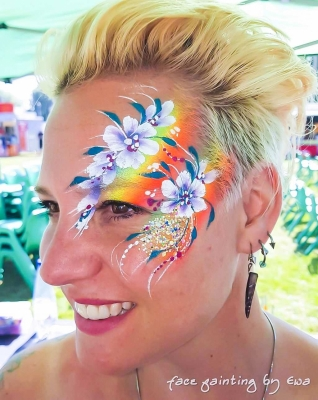 adults face paint rainbow flowery eye design Telford