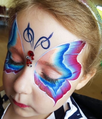 one stroke butterlfy face painting with gems Newport Shropshire