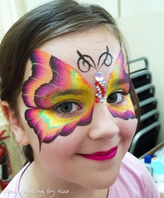 one stroke pink butterfly face painting with gems Telford